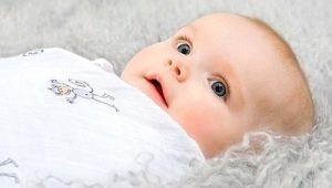 การห่อตัวทารกแรกเกิด: ข้อดีและข้อเสียทั้งหมดจนถึงอายุที่จะผูกมัดทารกและวิธีการเลือก
