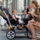 Kereta bayi untuk anak kembar: semakan model terbaik dan petua memilih