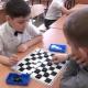 Checkers: regulile jocului pentru copiii începători și sfaturi privind predarea adulților