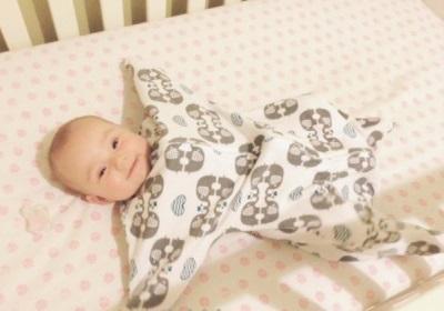Slaapzak met mouwen voor pasgeborenen
