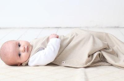 De samenstelling van een slaapzak voor pasgeborenen